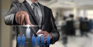 Businessman pressing on digital virtual screen, human resource Royalty Free Stock Photo
