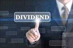 Businessman pressing DIVIDEND concept button. Stock Images