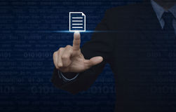 Businessman pressing document icon over computer binary code blu Stock Images