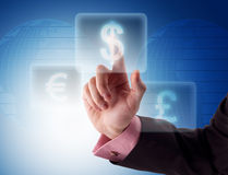 Businessman pressing dollar button Royalty Free Stock Photos