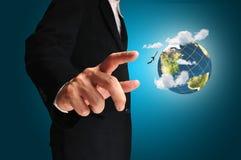 Businessman pressing earth globe Royalty Free Stock Photography