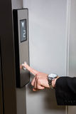 Businessman pressing elevator button Royalty Free Stock Image