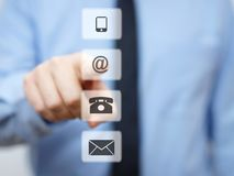 Businessman pressing email button, company support icons Stock Image
