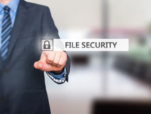 Businessman pressing File Security button on virtual screens Stock Images