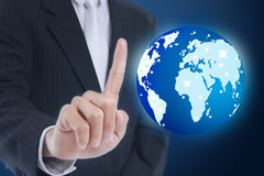 Businessman pressing globe Royalty Free Stock Photos
