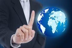 Businessman pressing globe Royalty Free Stock Photos
