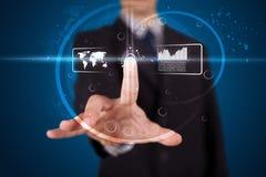 Businessman pressing high tech button Stock Photos