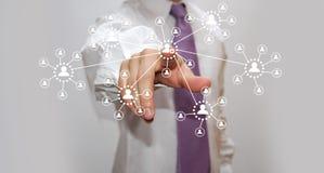 Businessman pressing high tech button Stock Images