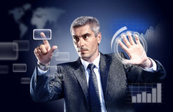 Businessman pressing high tech type of modern buttons on a virtual background Stock Photos