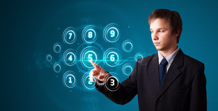 Businessman pressing high tech type of modern buttons Royalty Free Stock Images