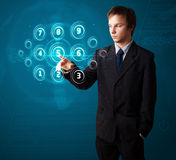 Businessman pressing high tech type of modern buttons Stock Photos
