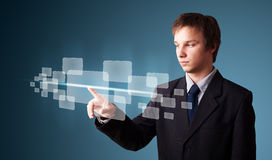 Businessman pressing high tech type of modern buttons Royalty Free Stock Image