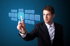 Businessman pressing high tech type of modern buttons Stock Photography