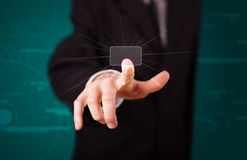Businessman pressing high tech type of modern buttons Royalty Free Stock Photo