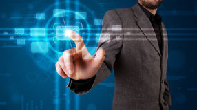 Businessman pressing high tech type of modern buttons Stock Image