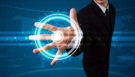 Businessman pressing high tech type of modern buttons Stock Photos
