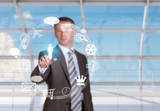 Businessman pressing on holographic screen Royalty Free Stock Image