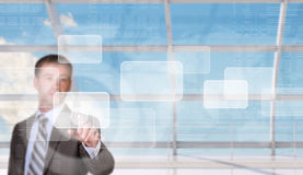Businessman pressing on holographic screen Stock Images