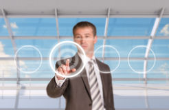 Businessman pressing on holographic screen Stock Photography