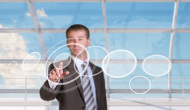 Businessman pressing on holographic screen Royalty Free Stock Photography