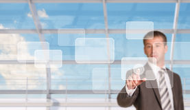 Businessman pressing on holographic screen Royalty Free Stock Photo