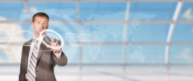 Businessman pressing on holographic screen Stock Photos