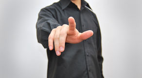 Businessman pressing an imaginary button Stock Images