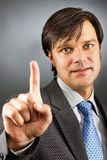 Businessman pressing an imaginary button Royalty Free Stock Images