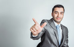 Businessman pressing an imaginary button Royalty Free Stock Image
