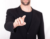 Businessman pressing an imaginary button Royalty Free Stock Photo