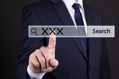 Businessman pressing an imaginary button on search bar with xxx Stock Images