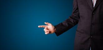 Businessman pressing imaginary button Stock Photos