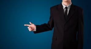 Businessman pressing imaginary button Royalty Free Stock Photos