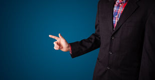 Businessman pressing imaginary button Stock Photography