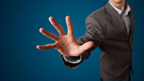 Businessman pressing imaginary button Royalty Free Stock Images