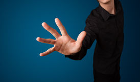 Businessman pressing imaginary button Stock Images