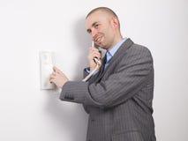 Businessman pressing an intercom Stock Images