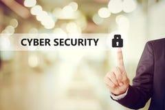 Businessman pressing key icon over blur background, cyber securi Stock Photo