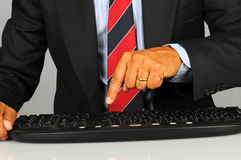 Businessman pressing key on keyboard Stock Photography