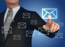 Businessman pressing mail icon 3d illustration Royalty Free Stock Images
