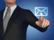 Businessman pressing mail icon 3d illustration Royalty Free Stock Photo