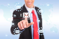Businessman pressing messaging Royalty Free Stock Photography
