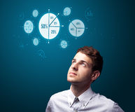 Businessman pressing modern business buttons Stock Photography