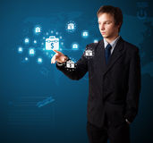 Businessman pressing modern business type of buttons Royalty Free Stock Image