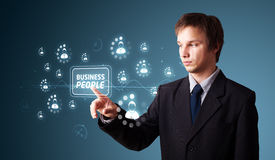 Businessman pressing modern business type of buttons Royalty Free Stock Images