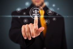 Businessman pressing modern business type of buttons Stock Photos
