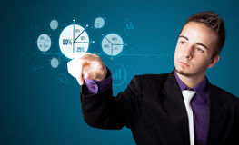 Businessman pressing modern business type of buttons Royalty Free Stock Photo