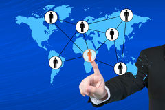 Businessman pressing modern social buttons on a virtual backgrou Stock Images