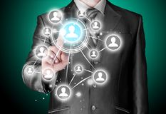 Businessman pressing modern social buttons Royalty Free Stock Image