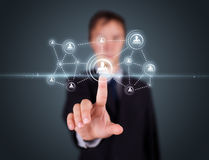 Businessman pressing modern social type of icons Stock Images